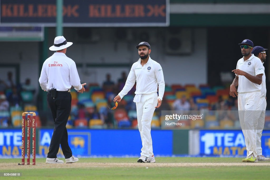 Indian cricket captain Virat kohli (2R) and Indian cricketer Ravichandran Ashwin(R) discuss with the on field umpire about a turned-down appeal after Kohli asked for a review during the 2nd Day's play in the 2nd Test match between Sri Lanka and India at the SSC international cricket stadium at the capital city of Colombo, Sri Lanka on Friday 04 August 2017.