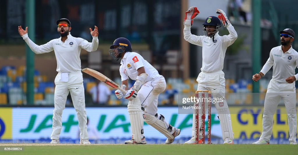 Indian cricket captain Virat Kohli (L) and Indian wicket keeper Wriddhiman Saha (3L) appeals unsuccessfully as Sri Lankan cricketer Kusal Mendis(2L) looks on during the 2nd Day's play in the 2nd Test match between Sri Lanka and India at the SSC international cricket stadium at the capital city of Colombo, Sri Lanka on Friday 04 August 2017.