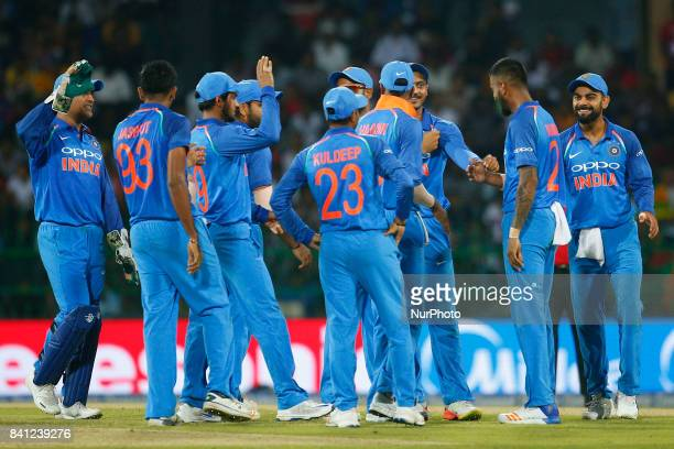 Indian cricket captain Virat Kohli and team members celebrate after the dismissal of Sri Lanka's Kusal Mendis the 4th One Day International cricket...