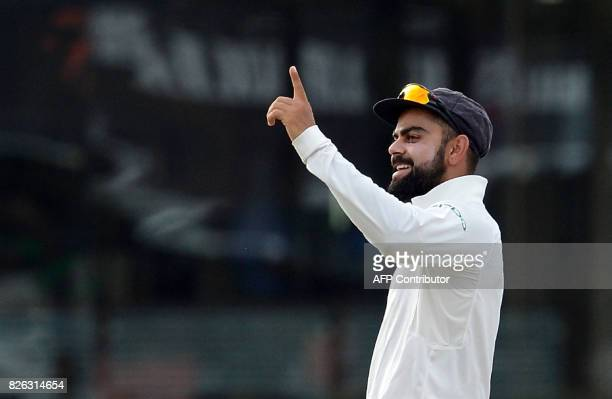 Indian cricket captain Virat Kohli celebrates after dismissed Sri Lankan cricketer Dimuth Karunaratne during the second day of the second Test match...