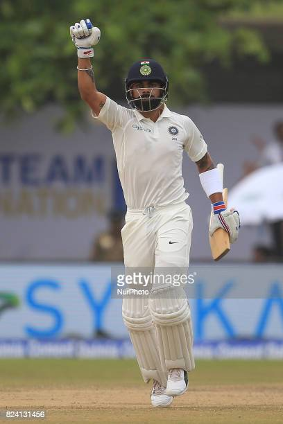 Indian cricket captain Virat Kohli celebrates after scoring 100 runs during the 4th Day's play in the 1st Test match between Sri Lanka and India at...