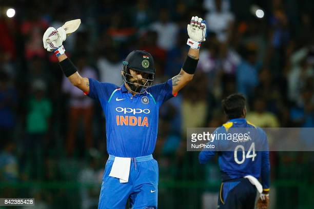 Indian cricket captain Virat Kohli celebrates after scoring 100 runs during the 5th and final One Day International cricket match between Sri Lanka...