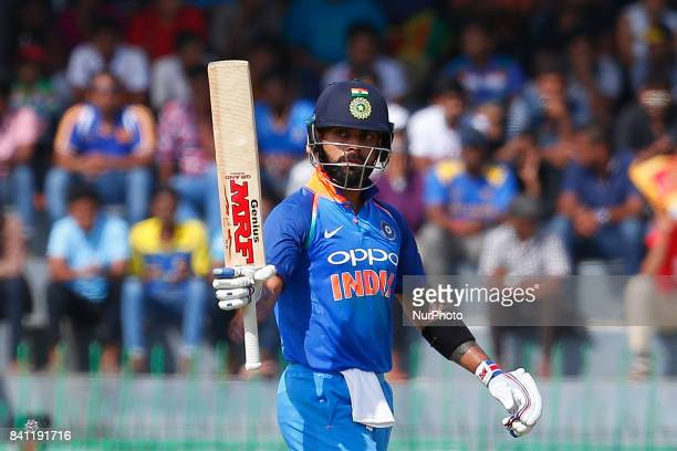 Indian cricket captain Virat Kohli celebrates after scoring 50 runs during the 4th One Day International cricket match between Sri Lanka and India at...
