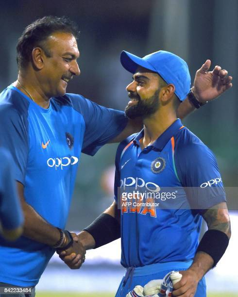 Indian cricket captain Virat Kohli celebrates with coach Ravi Shastri after victory in the final one day international cricket match between Sri...