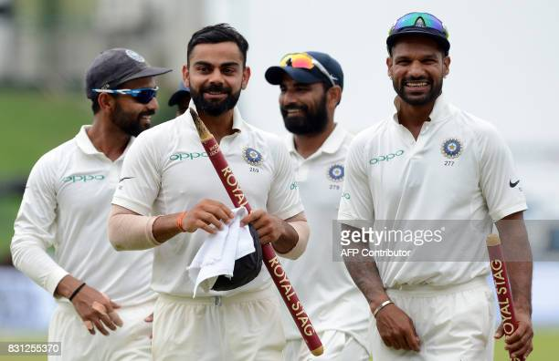 Indian cricket captain Virat Kohli celebrates with his teammates after victory in the third day of the third and final Test match between Sri Lanka...