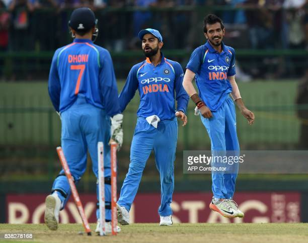 Indian cricket captain Virat Kohli celebrates with Yuzvendra Chahal after he dismissed Sri Lankan cricketer Danushka Gunathilaka during the second...