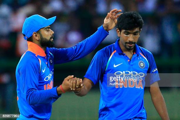 Indian cricket captain Virat Kohli congratulate Jasprit Bumrah during the 3rd One Day International cricket match between Sri Lanka and India at the...