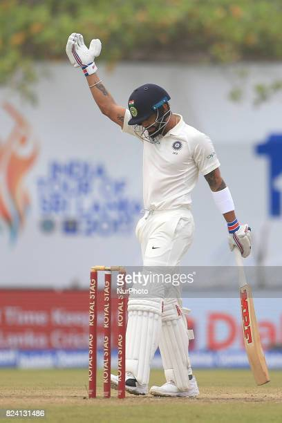 Indian cricket captain Virat Kohli gestures after playing a shot during the 4th Day's play in the 1st Test match between Sri Lanka and India at the...