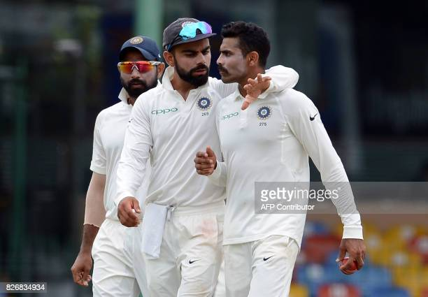 Indian cricket captain Virat Kohli instructs teammate Ravindra Jadeja during the fourth day of the second Test match between Sri Lanka and India at...