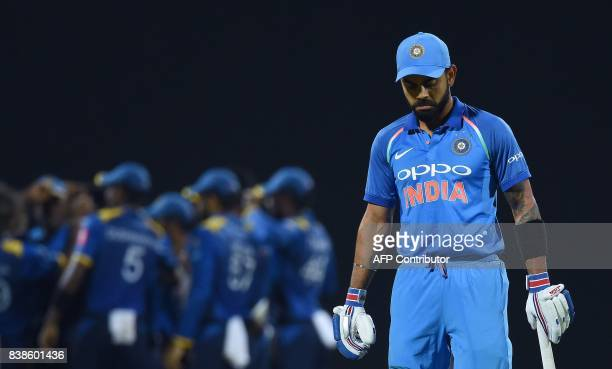 Indian cricket captain Virat Kohli leaves the pitch after being dismissed during the second One Day International cricket match between Sri Lanka and...