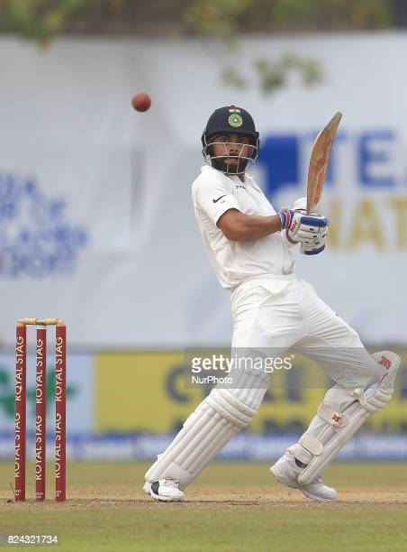 Indian cricket captain Virat Kohli plays a shot during the 4th Day's play in the 1st Test match between Sri Lanka and India at the Galle cricket...