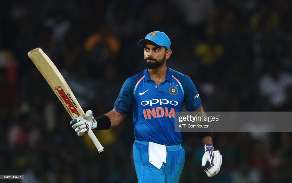 Indian cricket captain Virat Kohli raises his bat to the crowd after scoring a half-century (50 runs) during the final one day international (ODI) cricket match between Sri Lanka and India at R. Premadasa Stadium in Colombo on September 3, 2017. /