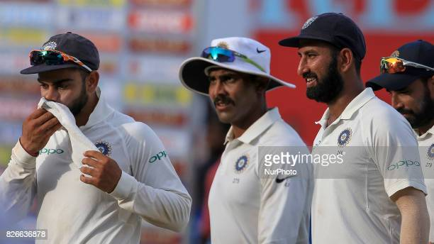 Indian cricket captain Virat Kohli Ravindra Jadeja Cheteshwar Pujara walk off at the end of 3rd Day's play in the 2nd Test match between Sri Lanka...