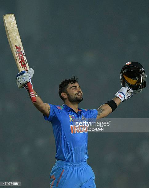 Indian cricket captain Virat Kohli reacts after scoring a century during the second match of the Asia Cup one-day cricket tournament between...