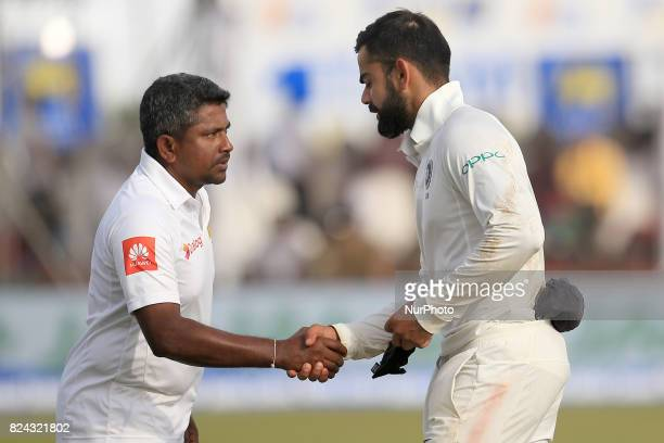 Indian cricket captain Virat Kohli shakes hands with Sri Lankan captain Rangana Herath after India defeated Sri Lanka by 304 runs during the 4th...