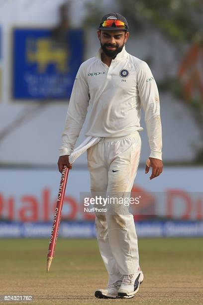 Indian cricket captain Virat Kohli walks off with a stump in his hands after India defeated Sri Lanka by 304 runs during the 4th Day's play in the...