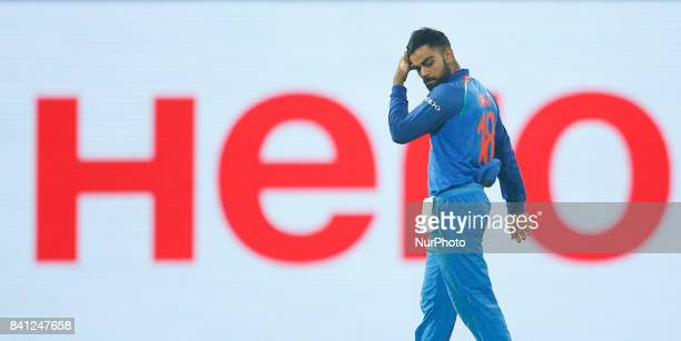 Indian cricket captain walks back to the pavilion after defeating Sri Lanka during the 4th One Day International cricket match between Sri Lanka and...