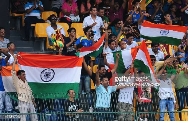 Indian cricket fan wave the Indian national flag during the third one day international match between Sri Lanka and India at the RPremadasa Cricket...