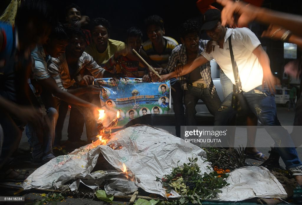 Indian cricket fans burn portraits of players as they stage a funeral of the Indian cricket team in the streets of Siliguri on March 31, 2016, after India's defeat in the men's semi-final match between India and West Indies in a World T20 cricket tournament match played at Mumbai. The West Indies achieved their 'mission' of shattering India's dreams of a World Twenty20 title on home soil after they stunned the hosts by seven wickets to reach the final on March 31, 2016. / AFP / DIPTENDU