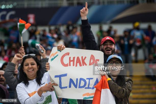 Indian cricket fans cheer and wave national flags during the ICC Champions trophy match between India and Pakistan at Edgbaston in Birmingham on June...