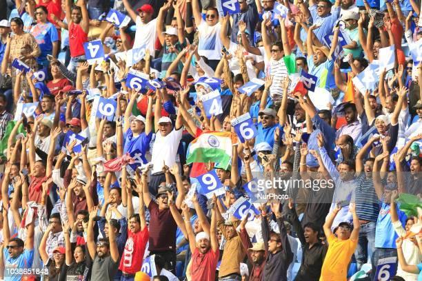 Indian cricket fans cheer during the Asia Cup 2018 cricket match between India and Pakistan at Dubai International cricket stadiumDubai United Arab...