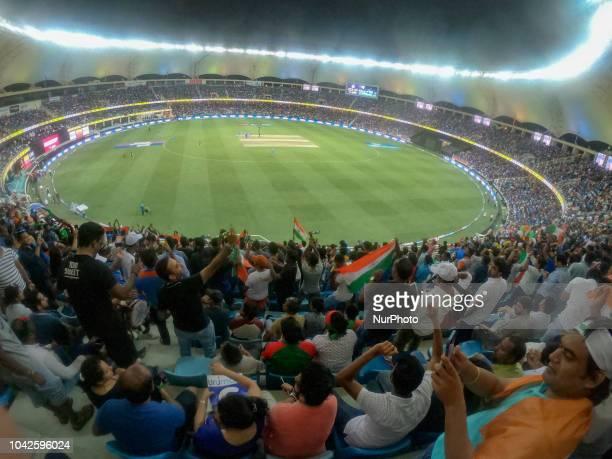 Indian cricket fans cheer during the final cricket match of Asia Cup 2018 between India and Bangladesh at Dubai International cricket stadium,Dubai,...