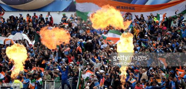 Indian cricket fans cheer during the ICC Champions Trophy match between India and Pakistan at Edgbaston on June 4 2017 in Birmingham England