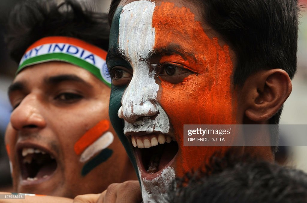 Indian cricket fans cheer in support of : News Photo
