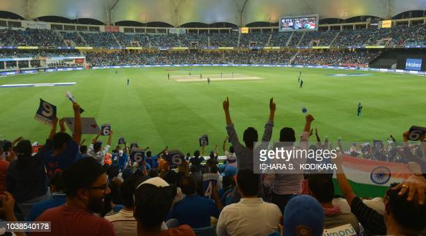 Indian cricket fans cheer in support of their national team during the one day international Asia Cup cricket match between Pakistan and India at the...