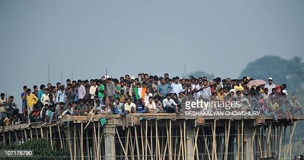 Indian cricket fans watch the first oneday International cricket match against New Zealand from a building under construction outside the Nehru...