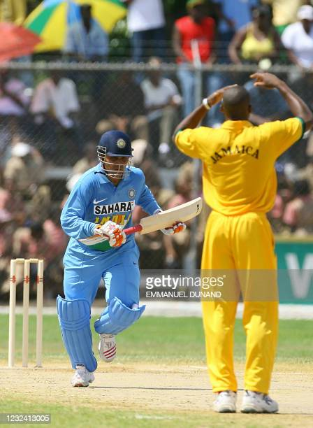 Indian cricket player Virender Sehwag scores a run off Jamaican bowler Darren Powell during their one day international warmup match in Montego Bay,...
