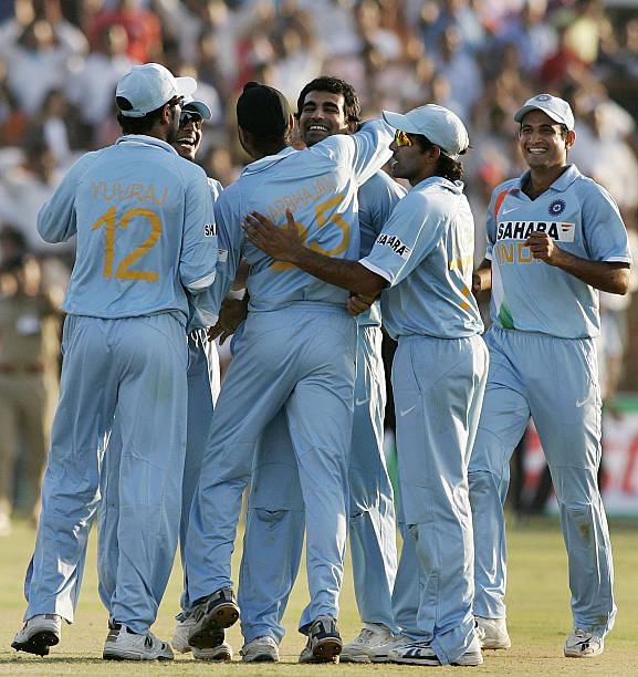 Indian cricket players celebrate after beating Australia during the fourth OneDay International match in Chandigarh 08 October 2007 India beat...