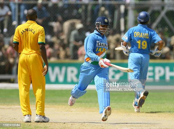 Indian cricket players Virender Sehwag and Rahul Dravid score a run off Jamaican bowler Darren Powell during their one day international warmup match...