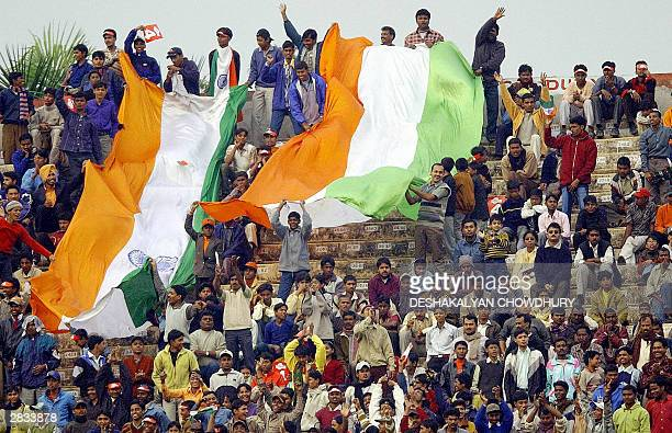 Indian cricket supporters wave their countries flag as they celebrate the India 'A' teams victory over Pakistan 'A' in the sixth match of the Kenstar...