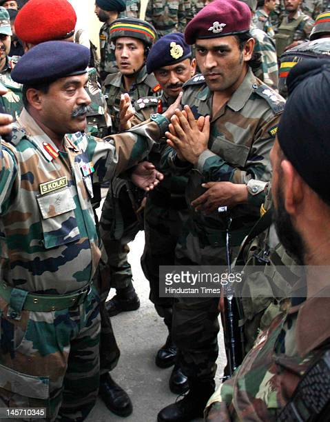 Indian cricket team captain Mahendra Singh Dhoni in his Army dress visits Baramulla garrison at the Thimayya Hall on June 3, 2012 some 50 kms from...