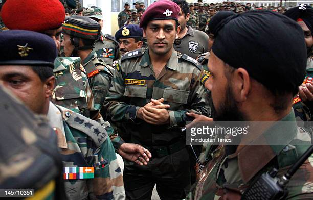Indian cricket team captain Mahendra Singh Dhoni in his Army dress visits Baramulla garrison at the Thimayya Hall on June 3 2012 some 50 kms from...