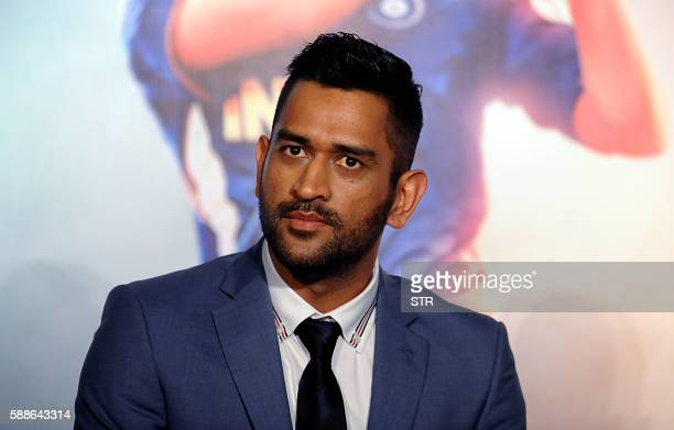 Indian cricket team captain Mahendra Singh Dhoni poses as he attends the trailer launch of his biographical forthcoming Hindi film MSDhoni directed...
