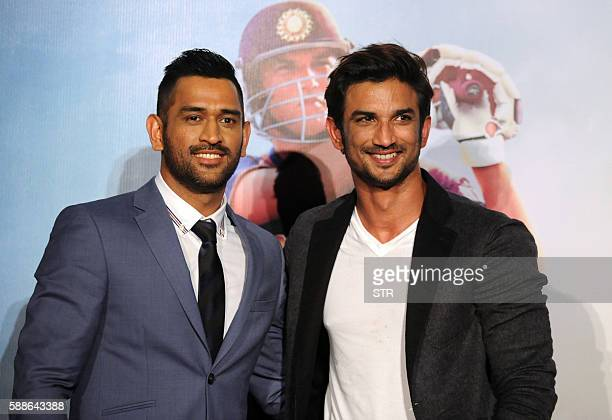 Indian cricket team captain Mahendra Singh Dhoni poses with Bollywood actor Sushant Singh as he attends the trailer launch of his biographical...
