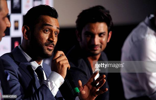 Indian cricket team captain Mahendra Singh Dhoni speaks alongside Bollywood actor Sushant Singh as he attends the trailer launch of his biographical...