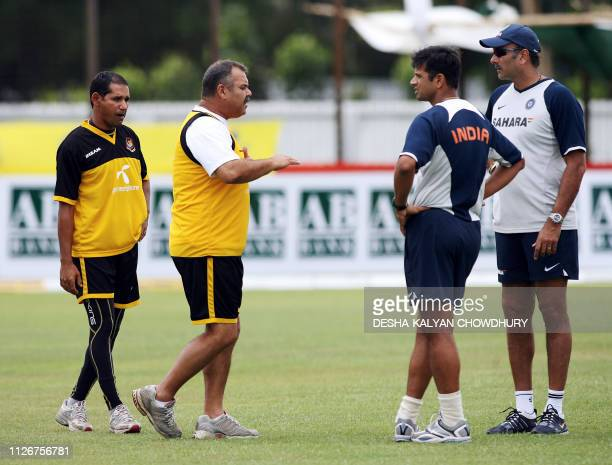 Indian cricket team captain Rahul Dravid and team manager Ravi Shastri listen to Bangladeshi coach Dev Whatmore watched by team captain Habibul...