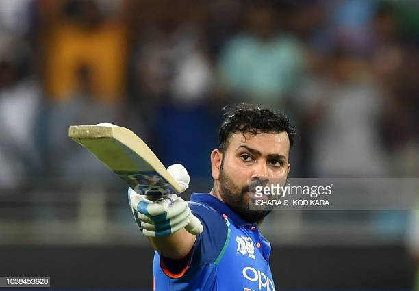 Indian cricket team captain Rohit Sharma celebrates after scoring a century during the one day international Asia Cup cricket match between Pakistan...