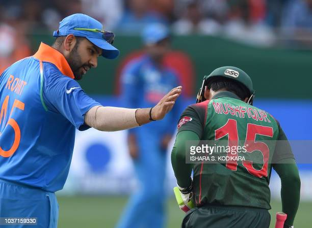 Indian Cricket team captain Rohit Sharma talks with Bangladesh batsman Mushfiqur Rahim during the one day international Asia Cup cricket match...