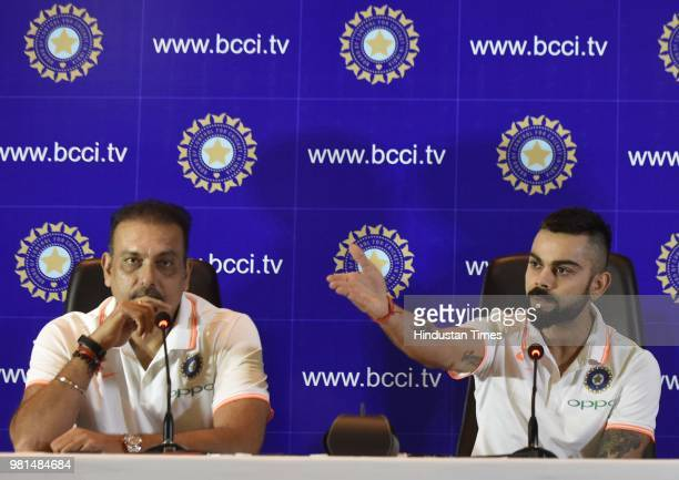 Indian Cricket Team captain Virat Kohli addresses the media before leaving for England Tour as Coach Ravi Shastri looks on at a hotel in Aero City on...