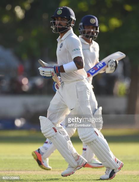 Indian cricket team captain Virat Kohli and Ajinkya Rahane run between the wickets during the first day of the twoday warmup match between Sri Lanka...
