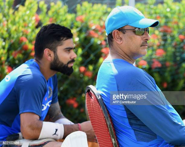 Indian cricket team captain Virat Kohli and newlyappointed coach Ravi Shastri take part in a practice session at Galle International Cricket Stadium...