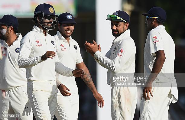 Indian cricket team captain Virat Kohli and teammates celebrate after dismissing Sri Lankan cricketer Kaushal Silva during the second day of the...