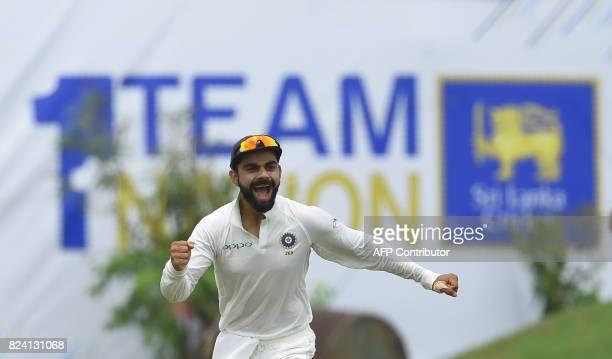 Indian cricket team captain Virat Kohli celebrates after dismissing Sri Lankan batsman Danushka Gunathilaka during the fourth day of the first Test...