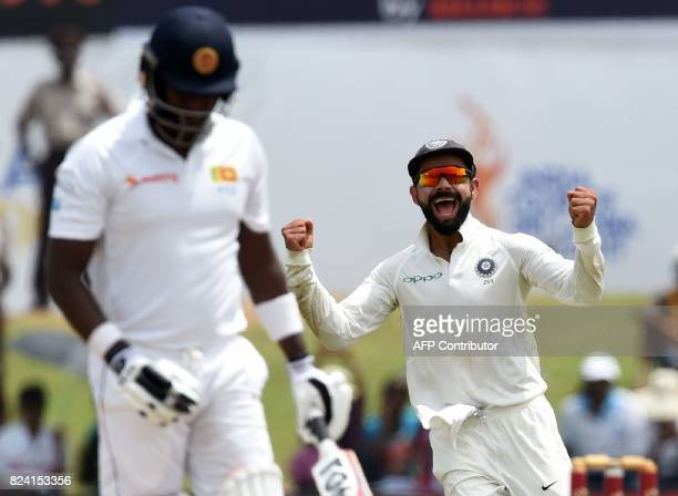 Indian cricket team captain Virat Kohli celebrates after dismissing Sri Lankan batsman Angelo Mathews during the fourth day of the first Test match...