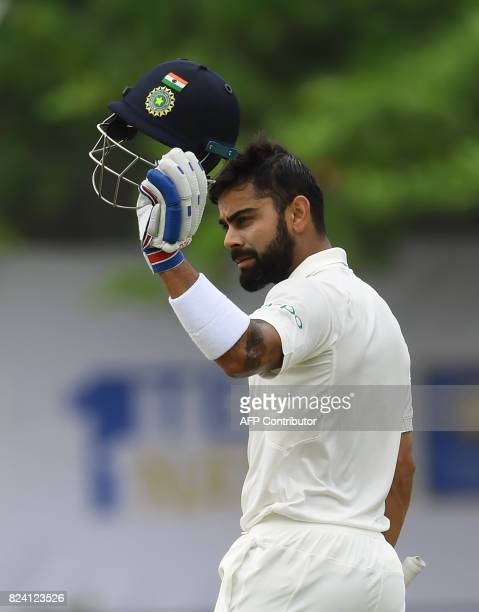 Indian cricket team captain Virat Kohli celebrates after scoring a century during the fourth day of the first Test match between Sri Lanka and India...
