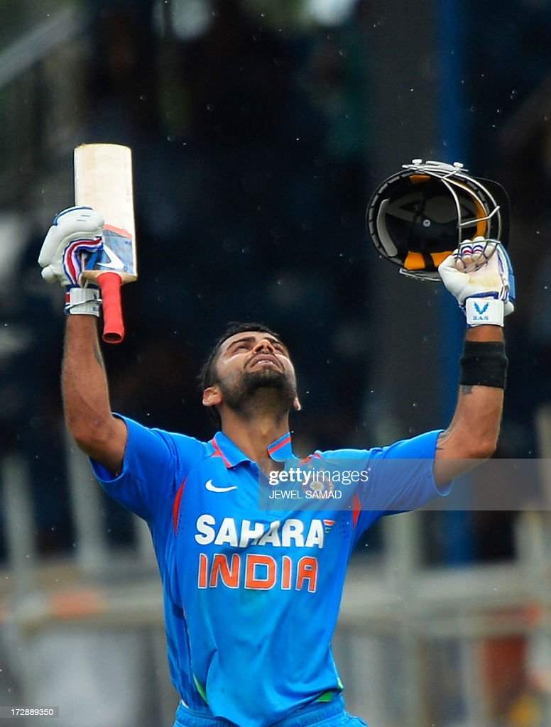 Indian cricket team captain Virat Kohli celebrates after scoring his century during the fourth match of the Tri-Nation series between India and West Indies at the Queen's Park Oval in Port of Spain on July 5, 2013. India have scored 311/7 at the end of their innings. AFP PHOTO/Jewel Samad
